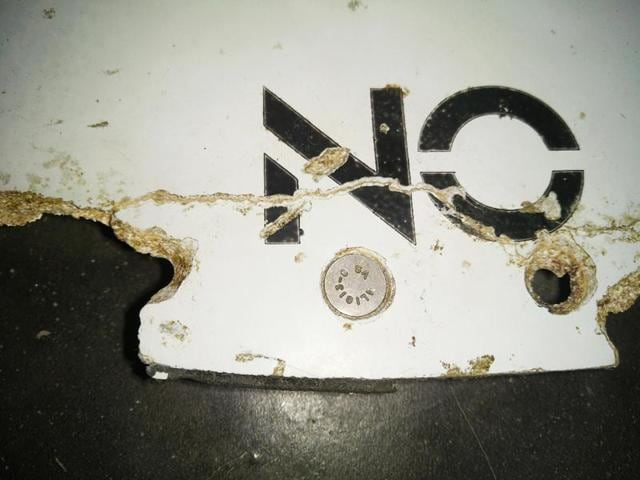 An undated handout photo taken in an undisclosed location and received from the Australian Transport Safety Bureau (ATSB) on March 3, 2016, shows a piece of aircraft debris found on the coast of Mozambique, suspected to be from Malaysian Airlines flight MH370.