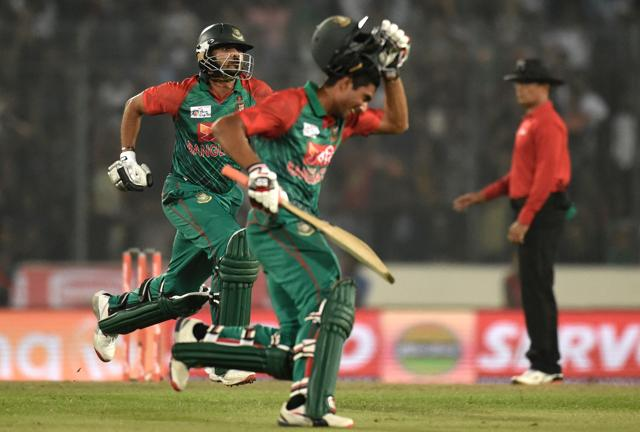 The Bangladesh cricket  team celebrates its win over Pakistan in theAsia Cup T20, their third straight win of the tournament.