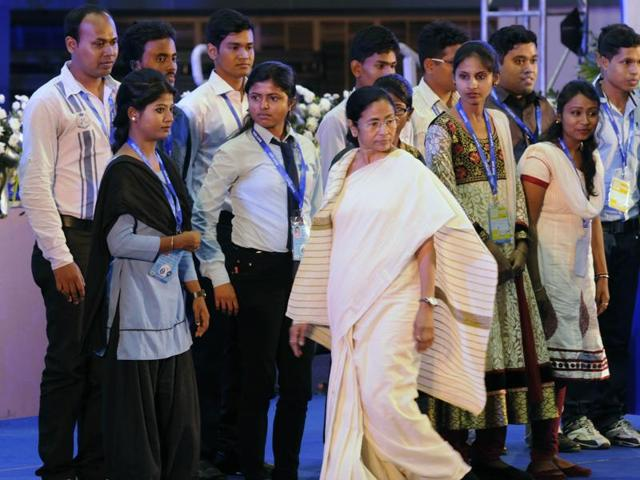 West Bengal chief minister Mamata Banerjee (R) awards the young achievers in the ITI training at Netaji Indoor Stadium in Kolkata.