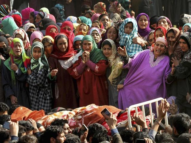 Women wail as they watch the body of a militant, during his funeral procession in Dadsar village, 40 kilometers (25 miles) south of Srinagar.