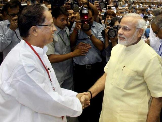 Narendra Modi shake hands with Assam chief minister Tarun Gogoi during the chief ministers' conference on internal security in New Delhi.