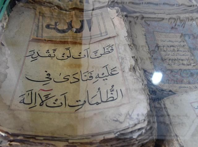This photograph taken on January 14, 2016, shows ancient copies of the Koran displayed in a tunnel at Jabl-e-Noor on the outskirts of Quetta.