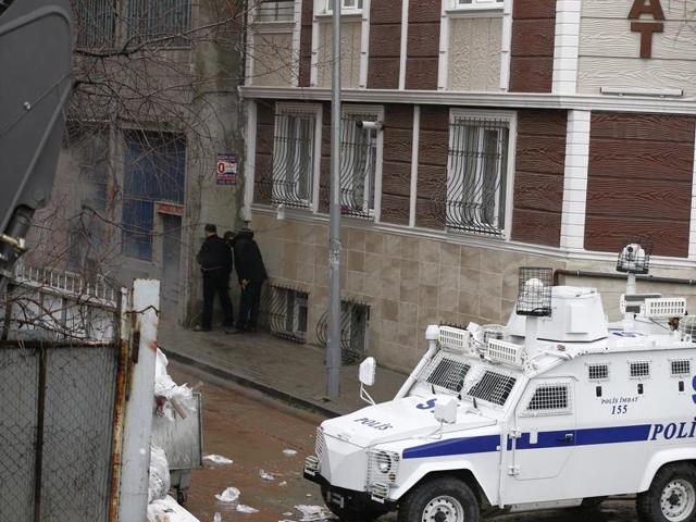 Security forces surround the area during an operation against two attackers, in Bayrampasa neighbourhood in Istanbul.