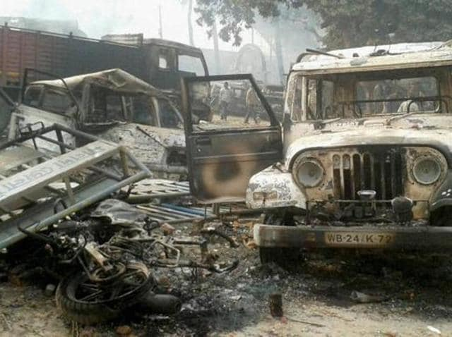 Vehicles set on fire after clashes between two groups at Kaliachak police station in Malda on Sunday, January 3, 2016.  Both CPI(M) and BJP think it was Mamata Banerjee's administration and Trinamool men who allowed, if not staged, the rioting at Kaliachak in which BSF men were assaulted and their vehicle was set afire.