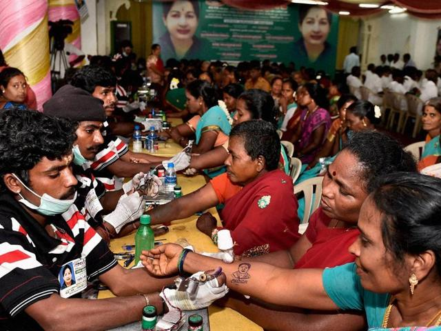 AIADMK party cadres getting the image of Tamil Nadu Chief Minister J Jayalalithaa tattooed on their hands. Tamil Nadu will have a single phase polling on May 16.