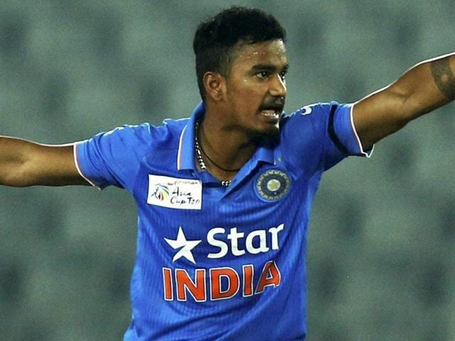 India's Pawan Negi unsuccessfully makes a leg before wicket appeal during the Asia Cup  match against UAE.