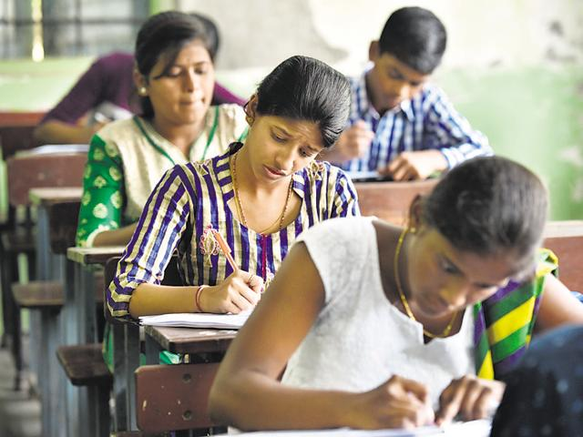 Students taking SSC exam at a school in Mumbai on Tuesday.