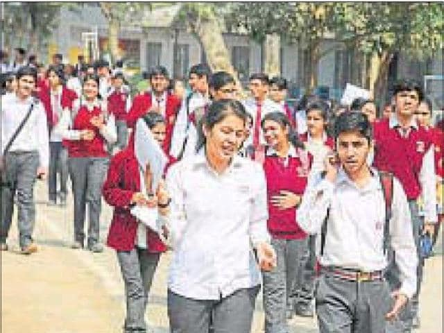 Students coming out of an exam centre in Gurgaon.
