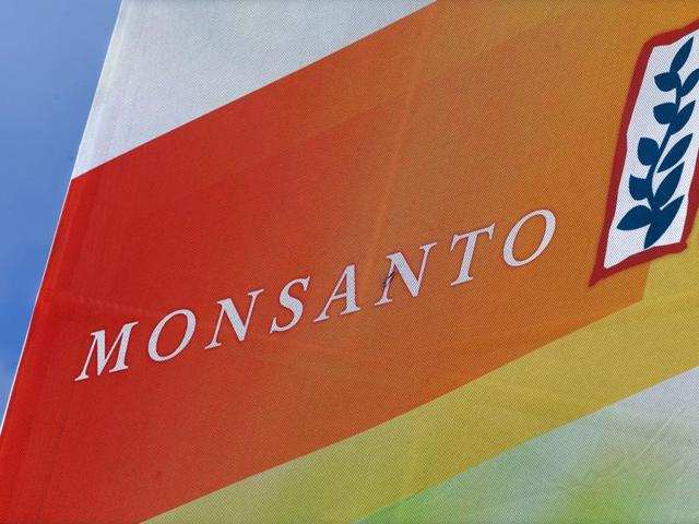 Monsanto has threatened to pull out of India if the government imposed a big cut in royalties that local firms pay for its genetically modified cotton seeds.