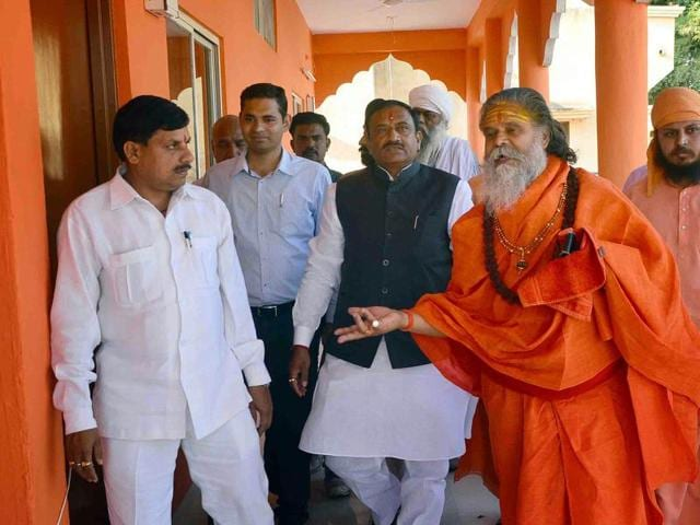 Incharge minister Bhupendra Singh and Narendra Giri (R) after a closed door meeting in Ujjain on Thursday.