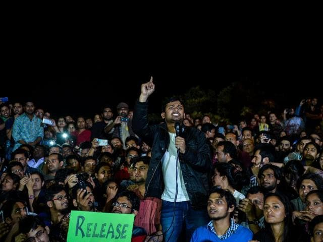 Jawaharlal Nehru University student union leader Kanhaiya Kumar makes a speech to fellow students after being released on bail at the university campus,(AP)
