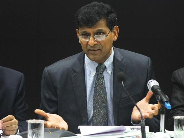 In this file photo, RBI governor Raghuram Rajan laughs while replying to a question during a news conference after the bi-monthly monetary policy review in Mumbai.