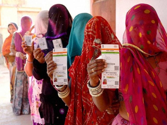A villager goes through the process of eye scanning for Unique Identification database system at an enrolment centre at Merta, Rajasthan.