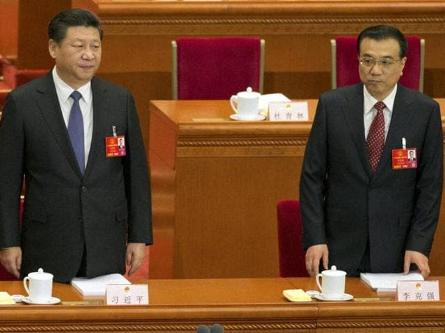 Chinese President Xi Jinping, left and Chinese Premier Li Keqiang arrive for the opening session of the annual National People's Congress in Beijing's Great Hall of the People on Saturday.