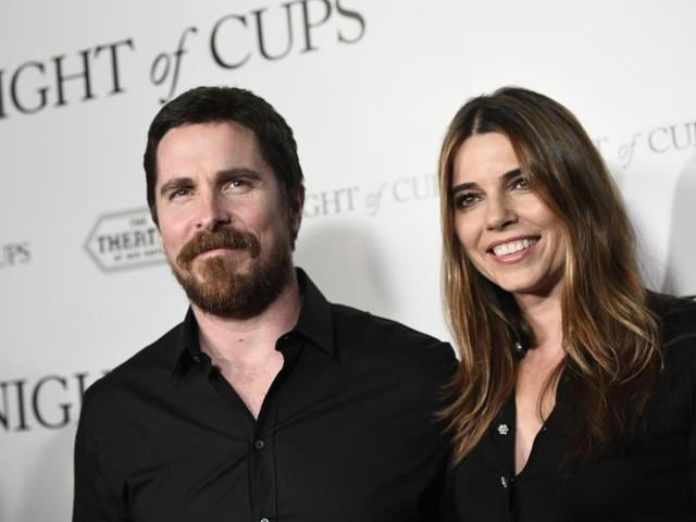 Christian Bale, left, a cast member in Knight of Cups, poses with his wife Sibi Blazic at the premiere of the film in Los Angeles.