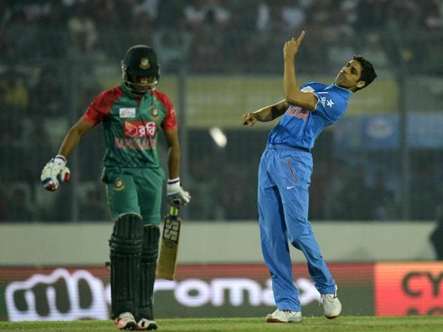 Indian pacer Ashish Nehra reacts after the dismissal of Bangladesh batsman Mohammad Mithun during a Twenty20 cricket match at The Sher-e-Bangla National Cricket Stadium in Dhaka.