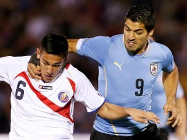 Barcelona's Suarez was suspended for nine games after biting Italy's Giorgio Chiellini at the World Cup in Brazil.