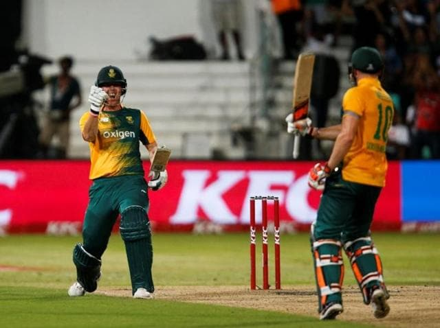 South Africa's Kyle Abbott (L) and David Miller celebrate beating Australia in their first T20 International cricket match in Durban.