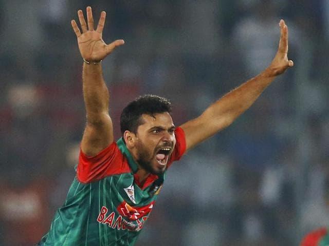Bangladesh cricket captain Mashrafe Bin Mortaza celebrates after the dismissal of Shaiman Anwar.