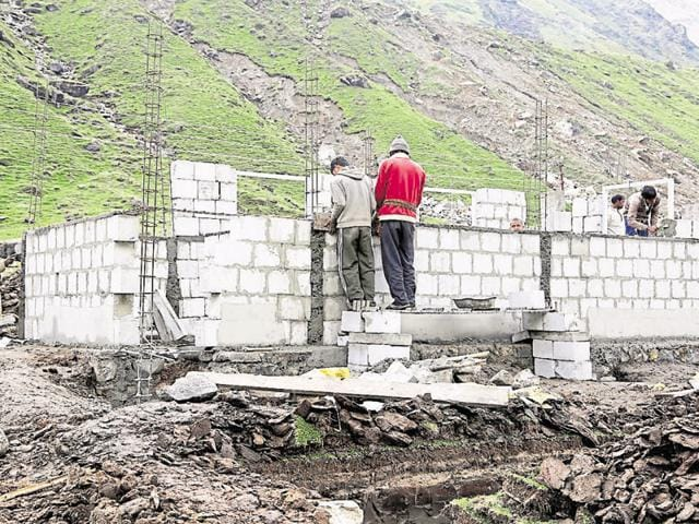 Workers construct earthquake-resistant buildings near the shrine in Kedarnath.