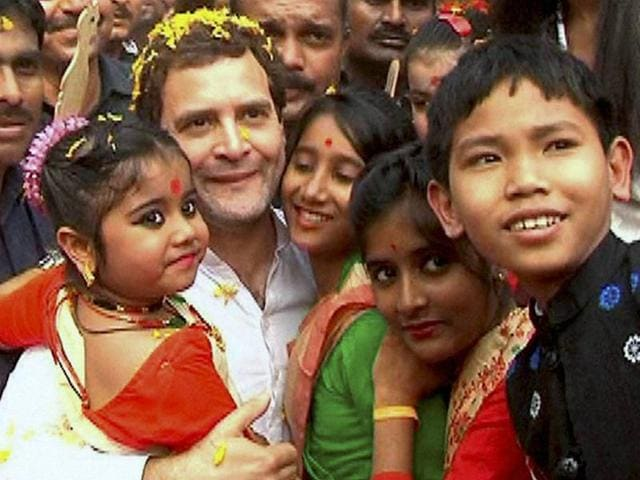 Congress vice-president Rahul Gandhi poses for photographs with children during his Padyatra in Nagaon on Saturday.