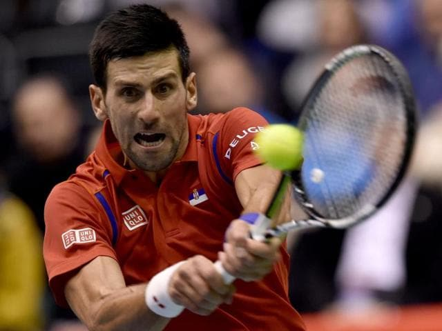Novak Djokovic returns a shot to  Aleksandr Nedovyesov during the Davis Cup World Group.