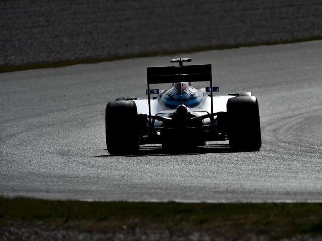 Ferrari's Finnish driver Kimi Raikkonen drives at the Circuit de Catalunya.