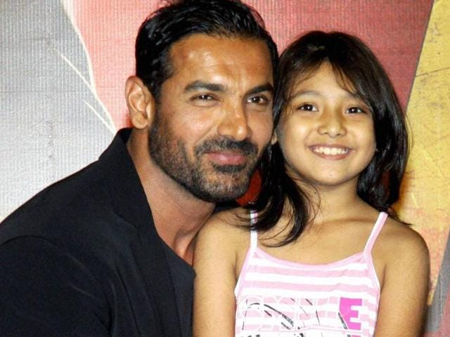 Bollywood actor John Abraham with child artist Divya Chalwad during the trailer launch of their upcoming film Rocky Handsome in Mumbai on Friday.