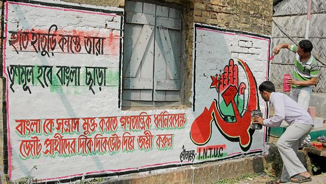 Wall graffiti declares alliance in Birbhum district as slogan on wall reads 'hand along with star and sickle will drive TMC out'.