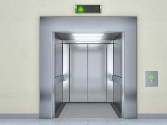 The woman was discovered after maintenance workers came to repair the elevator, one month after cutting power to it.
