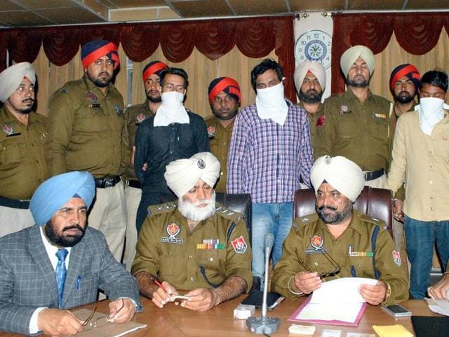 Superintendent of police (operations) Hargobind Singh (centre) at a press conference in Bathinda on Saturday. The accused with covered faces stand behind.