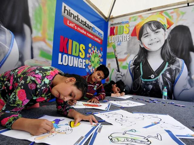 Kids enjoy colouring and drawing with free kits at the Palate Fest in Chandigarh on Saturday.