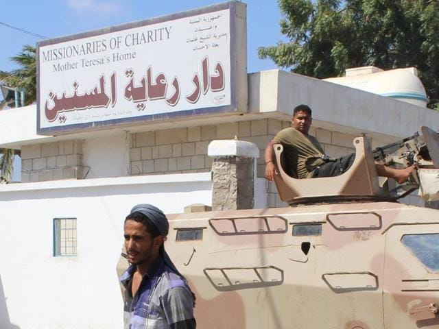 Yemeni security forces gather outside an elderly care home after it was attacked by gunmen in the port city of Aden on Friday.