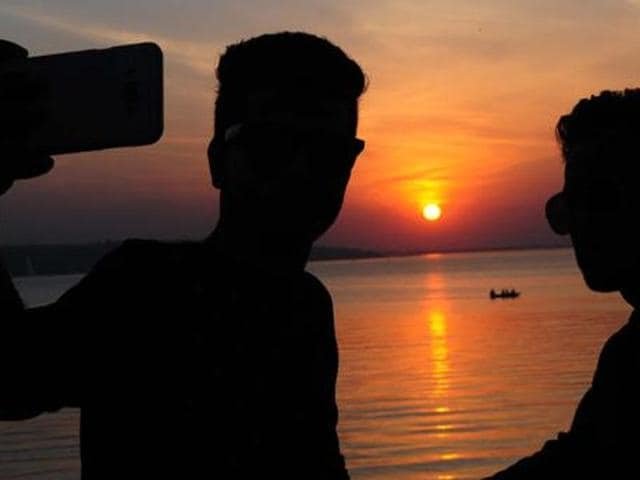 File photo of two friends clicking selfie on the bank of Upper lake in Bhopal on Thursday, December 31, 2015.