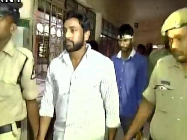 Ravela Susheel, son of senior Telugu Desam Party leader and social justice minister Ravela Kishore Babu, surrendered on Saturday after police registered a case against him and his driver(in blue shirt) for sexual assault.