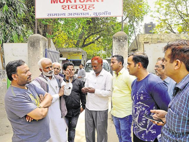 Relatives of Saifuddin Mohammed wait for his body at the mortuary in Gurgaon. Mohammed was mowed down by speeding car near NorthCap university on Friday.