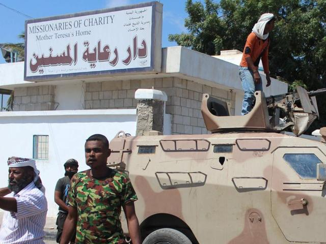 Yemeni security forces gather outside an elderly care home in Yemen's main southern city of Aden after it was attacked by gunmen on March 4.