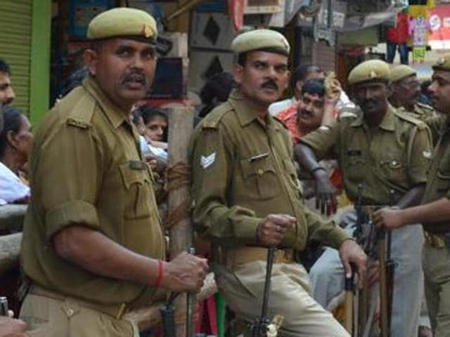 Police officers stand guard outside the Kashi Vishwanath temple in Varanasi on Monday.
