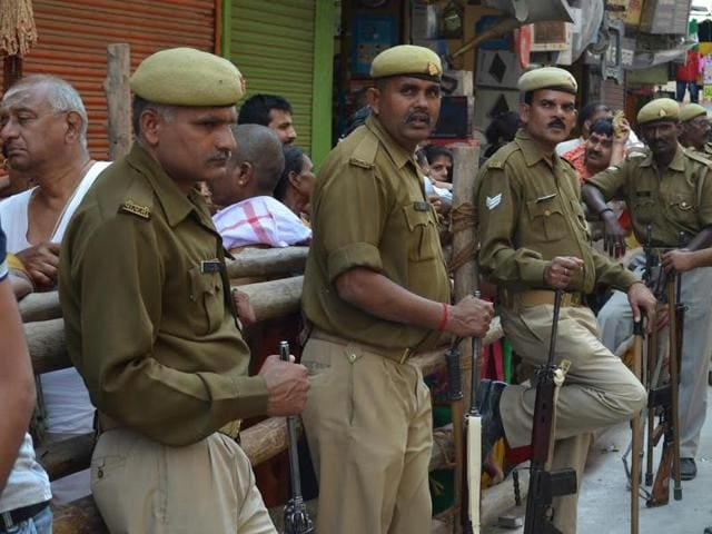 Police officers on duty outside the Kashi Vishwanath temple in Varanasi on Monday.