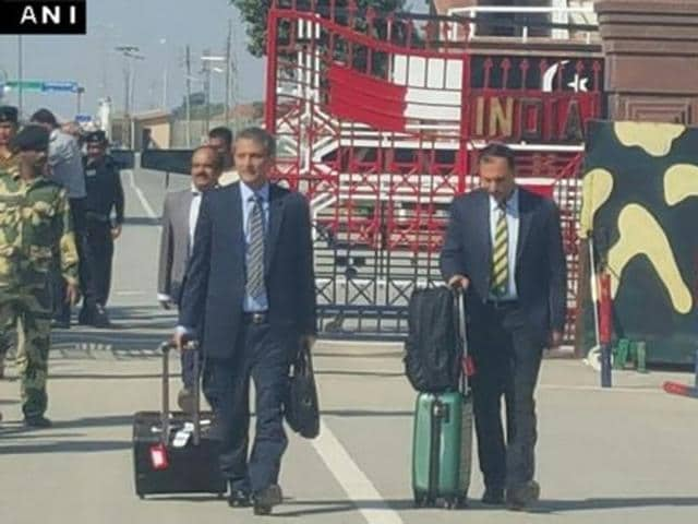 Usman Anwar, a DSP with the Federal Investigation Agency (FIA) of Pakistan and Azam Khan, a member of the Pakistan Cricket Board (PCB), cross the Attari checkpost into India.