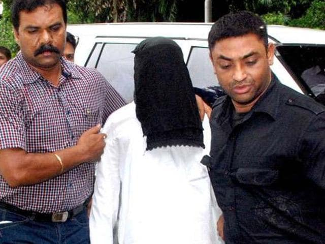 File photo of Abu Jundal, one of the handlers in the 26/11 Mumbai attacks, being taken into the crime branch custody in Mumbai.