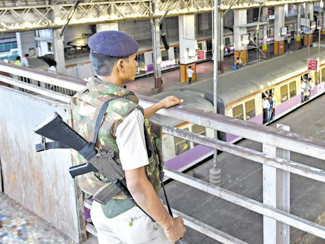 An RPF personnel stands on guard at the CST station as a red alert was sounded in Mumbai on Sunday..