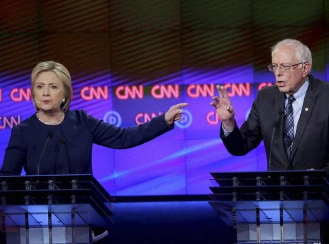 Democratic presidential candidates Hillary Clinton and Senator Bernie Sanders during a CNN debate at the Cultural Center Campus in Flint on Sunday night.