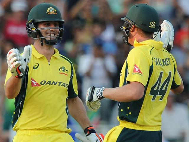 Australia's batsman Glenn Maxwell, left, congratulates teammate David Warner, right, on reaching a half-century during the second T20 against South Africa at the Wanderers stadium in Johannesburg on March 6, 2016.