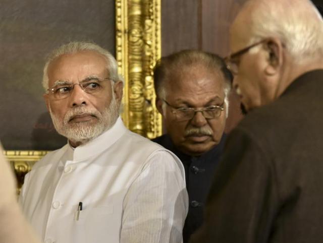 Modi's Aadhaar Bill may choke Advani's citizenship card plan