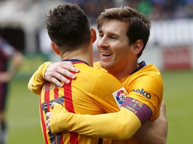 Eibar's Ander Capa in action against Barcelona's Lionel Messi during their La Liga match at the Ipurua Stadium on March 6, 2016.