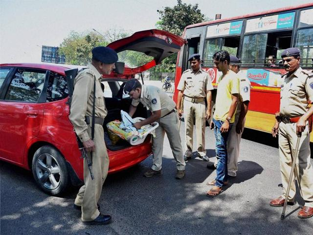 Police check vehicle after high alert in Ahmedabad. State home department has heightened security in the state following the Intelligence Bureau's warning of a possible terror attack on Gujarat.