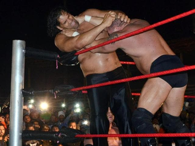 Dalip Singh Rana, popularly known as Great Khali, fighting with Brody Steele during a Pro-Wrestling match at the Guru Nanak Dev Stadium in Ludhiana on Saturday.