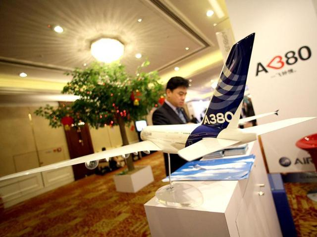 A delegate gets information from an Airbus booth in Beijing.
