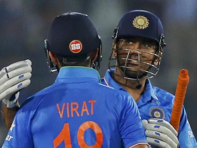 Indian captain Mahendra Dhoni and Virat Kohli celebrate after winning the Asia Cup Twenty20 international cricket final match against Bangladesh in Dhaka.